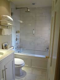 Idea for when we remodel our guest bathroom. Love the bathtub, rain  showerhead, glass door. It feels open even though it's a small bathroom