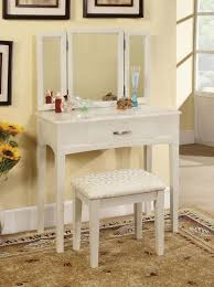 minimalist white stained wooden makeup vanity table with triple mirror and cutty stool on light brown carpet plus cream painted wall