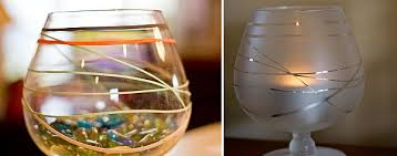 Rubber band the glass, spray frosted glass spray paint (from hardware store  or online), let dry & remove bands. Add a candle inside.