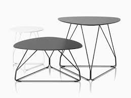 three polygon wire occasional tables one is white with a round top and the other