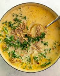 overhead shot of soup pot filled with zuppa toscana soup with ladel in it creamy