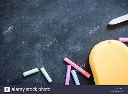 classroom chalkboard. stock photo - chalkboard in classroom background with sponge chalk eraser