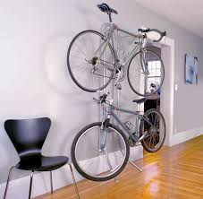 An Art of Storage Michelangelo Two Bike Gravity Storage Rack is leaning  against a gray wall