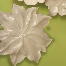 The set of three white flowers would look especially beautiful in a nursery, above a doorway, or as part of a gallery wall. Ceramic Flower Wall Art Ideas On Foter