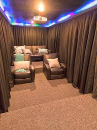 a diy home theater room hang curtains around your seats for increased darkness during the