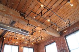 industrial lighting ideas. this enormous installation is a network of pipes and light bulbs that would look great in industrial lighting ideas u