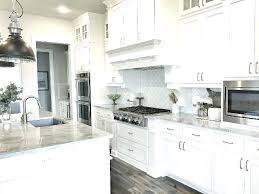 white kitchen gray countertops a white kitchen cabinets