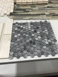 gray penny mosaic tiles for the master shower floor img 0974