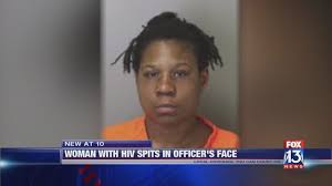 HIV positive woman arrested after spitting in police officer's face ...