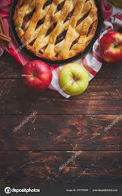Homemade Pastry Apple Pie With Bakery Products On Dark Wooden