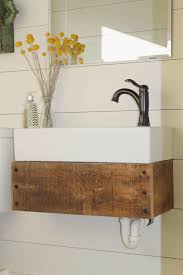 diy floating vanity from reclaimed wood girl meets carpenter towel holder on the side of bathroom sink floating vanity girl meets