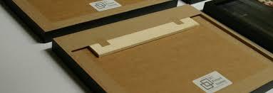 split baton hanging system with art bak conservation backing board