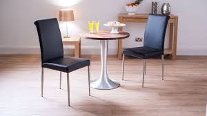 2 seater round dining table and black dining chairs