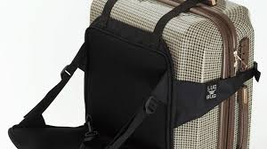 A child's travel chair that attaches to your rolling suitcase in seconds  without taking up extra space.