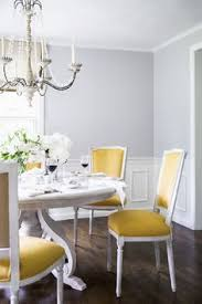 yellow dining chairs grey walls dining room abby larsons home tour