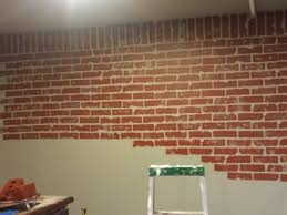 painting brick wallsFaux brick wall in progress Painted wall grey then used dollar