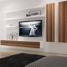 This charming floating composition which combines the BRANDO floating  entertainment unit, wall cabinets and floating