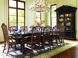 tommy bahama furniture with rattan dining chairs and crown chandelier plus feizy rug for traditional