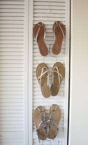 hang flip flops from a wire hanger to keep them together