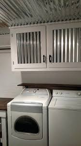 corrugated tin cabinets march laundry room after corrugated tin ceiling and tin in cabinet doors diy corrugated tin