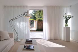 living room with modern floor lamp and minimalist furniture also white sliding door curtains