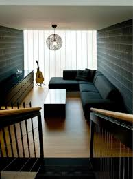 Black Sofa Color With Black Brick Wall And Wooden Floor For Narrow Living  Room Layout For