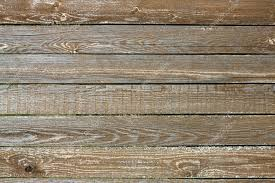 Fence from wooden horizontal planks as background closeup Stock