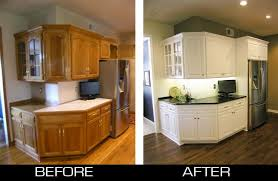 before and after refacing oak kitchen cabinet to white kitchen cabinet with black granite countertop