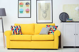 Living room with yellow color couch