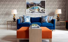 wall patterns with bold furniture orange and blue