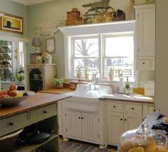 Shelf above kitchen window; Photo by Morrow Kitchen & Bath Designers, The  Workshops of