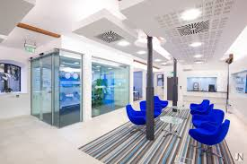 bank and office interiors. A Much Newer Bank Than AIB Or BOI, KBC Have Really Adopted The Minimalist Approach. Instead Of Long Lines Behind Rope Barriers, Visitors Are Greeted With And Office Interiors