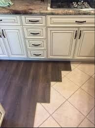 can you lay wood floor over tile