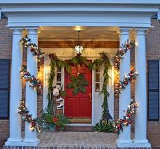 porch with snowflake wreath and lit garland