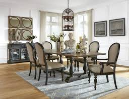 arlington round sienna pedestal dining room table w chestnut finish. the cambria table is a x distressed two-tone on black trestle base with large vase turned pedestals dark toffee rub finish showing through arlington round sienna pedestal dining room w chestnut t