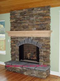 classic style fireplace installation with natural chimney masonry and closed wood burning hearth for indoor heating