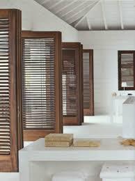 view in gallery dark wood indoor shutters