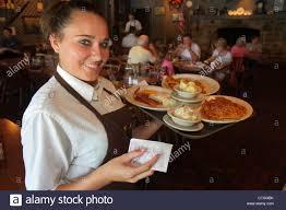stuart florida cracker barrel restaurant old country store stuart florida cracker barrel restaurant interior w waitress job serving tray food plates pancake stock