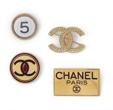 chanel pin. chanel, four chanel logo pin brooches, 1980s - 2004 auction 1082 hommage à coco c