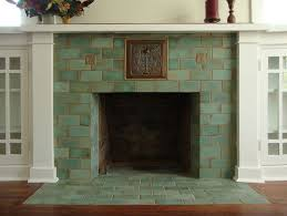 celadon fireplace a couple of batchelder revival tiles set against high fired field tiles make a clean fresh fireplace for a craftsman home by roa
