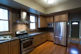 Wood Floor Kitchen Simple Kitchen Furniture And Refrigerator With Black Cabinet And