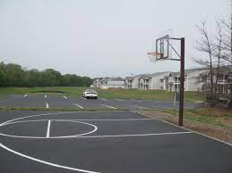 Basketball is a team sport in which two teams of five players score points by shooting (throwing) a ball through an elevated hoop located on either side of the rectangular court. Basketball Court Sealed With Coal Tar Sealcoat