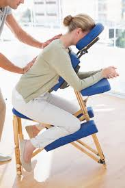 chair massage. woman having back massage in medical office chair