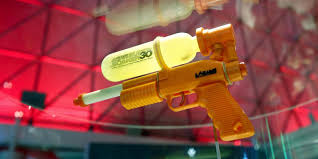 Elaborate squirt gun game has teens competing and running naked in.