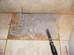 use an old chisel to remove existing tile set