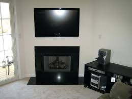 how to hide tv wires over fireplace mounting above fireplace hiding wires