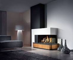 interior brown wooden fireplace base connected by black metal fire box and white floor lamps
