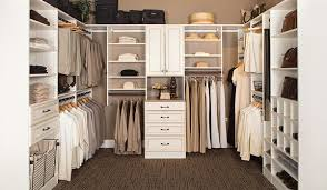 custom walk in closets. Plain Closets Custom Walk In Closets Design With Hidden Ironing And Laundry Organizers In Custom Walk Closets Closet Works