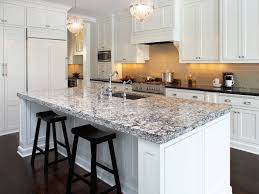 Cambria Quartz countertops, chrome country hardware, white stain cabinets,  dark floor - that's