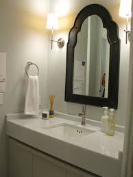 elegant black wooden bathroom cabinet. interior rectangle white wash basin in the bathroom vanity connected by black wooden mirror and elegant cabinet u